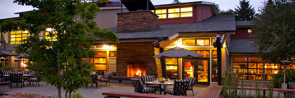 an outdoor fireplace outside copperleaf restaurant